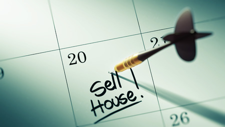 sell house: Concept image of a Calendar with a golden dart stick. The words Sell House written on a white notebook to remind you an important appointment.