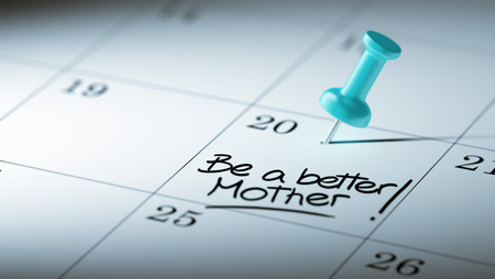 mother to be: Concept image of a Calendar with a blue push pin. Closeup shot of a thumbtack attached. The words Be a better mother written on a white notebook to remind you an important appointment. Stock Photo