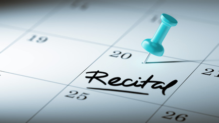 recital: Concept image of a Calendar with a blue push pin. Closeup shot of a thumbtack attached. The words Recital written on a white notebook to remind you an important appointment. Stock Photo