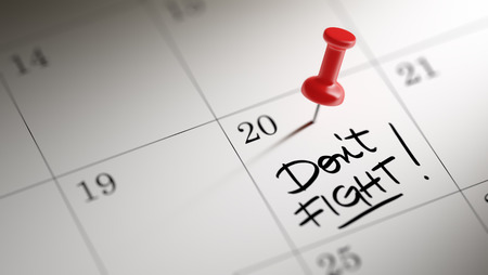 dont: Concept image of a Calendar with a red push pin. Closeup shot of a thumbtack attached. The words Dont Fight written on a white notebook to remind you an important appointment. Stock Photo