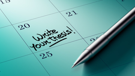 thesis: Closeup of a personal agenda setting an important date written with pen. The words Write your thesis written on a white notebook to remind you an important appointment. Stock Photo