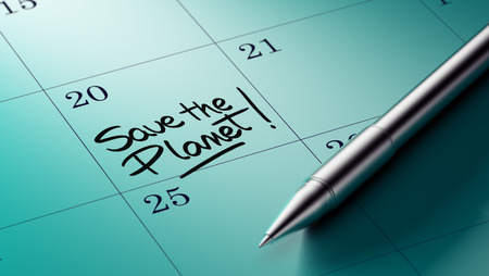 important date: Closeup of a personal agenda setting an important date written with pen. The words Save the Planet written on a white notebook to remind you an important appointment. Stock Photo