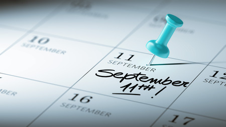 11th: Concept image of a Calendar with a blue push pin. Closeup shot of a thumbtack attached. The words September 11th written on a white notebook to remind you an important appointment. Stock Photo