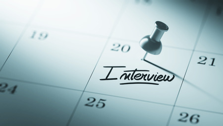 oral communication: Concept image of a Calendar with a push pin. Closeup shot of a thumbtack attached. The words Interview written on a white notebook to remind you an important appointment. Stock Photo