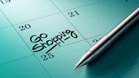 go to the shopping: Closeup of a personal agenda setting an important date written with pen. The words Go shopping written on a white notebook to remind you an important appointment.