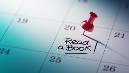 appointment book: Concept image of a Calendar with a red push pin. Closeup shot of a thumbtack attached. The words Read a book written on a white notebook to remind you an important appointment. Stock Photo