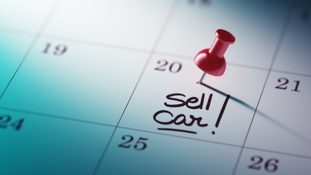 sell car: Concept image of a Calendar with a red push pin. Closeup shot of a thumbtack attached. The words Sell Car written on a white notebook to remind you an important appointment. Stock Photo