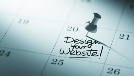 website words: Concept image of a Calendar with a push pin. Closeup shot of a thumbtack attached. The words Design your website written on a white notebook to remind you an important appointment. Stock Photo