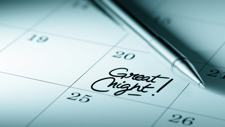 written date: Closeup of a personal agenda setting an important date written with pen. The words Great Night written on a white notebook to remind you an important appointment. Stock Photo