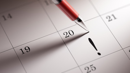 important date: Closeup of a personal agenda setting an important date written with pen. Stock Photo