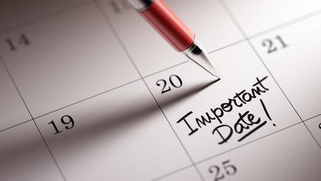 written date: Closeup of a personal agenda setting an important date written with pen. The words Important date written on a white notebook to remind you an important appointment.