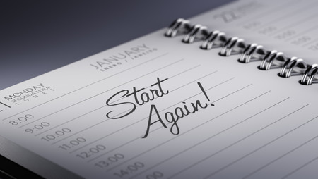 back in an hour: Closeup of a personal calendar setting an important date representing a time schedule. The words Start Again written on a white notebook to remind you an important appointment. Stock Photo