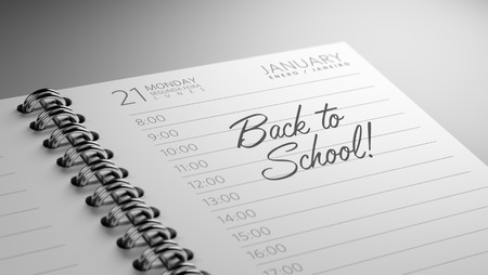 back in an hour: Closeup of a personal calendar setting an important date representing a time schedule. The words Back to school written on a white notebook to remind you an important appointment.