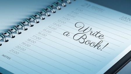 date book: Closeup of a personal calendar setting an important date representing a time schedule. The words Write a Book written on a white notebook to remind you an important appointment.