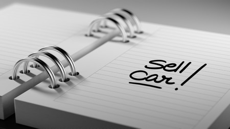 sell car: Closeup of a personal agenda setting an important date representing a time schedule. The words Sell Car written on a white notebook to remind you an important appointment.