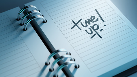 up to date: Closeup of a personal agenda setting an important date representing a time schedule. The words Time up written on a white notebook to remind you an important appointment. Stock Photo