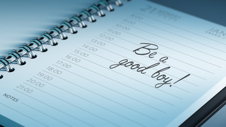 good boy: Closeup of a personal calendar setting an important date representing a time schedule. The words Be a good boy written on a white notebook to remind you an important appointment.