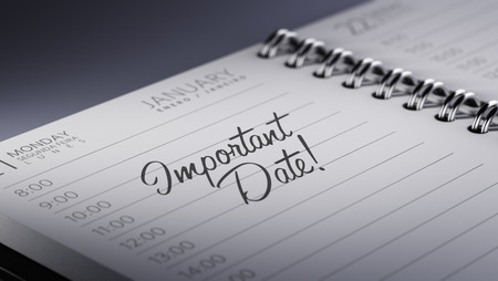 important date: Closeup of a personal calendar setting an important date representing a time schedule. The words Important date written on a white notebook to remind you an important appointment.