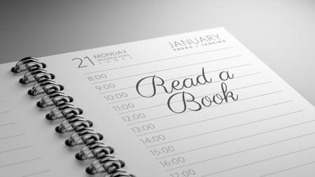 appointment book: Closeup of a personal calendar setting an important date representing a time schedule. The words Read a book written on a white notebook to remind you an important appointment.