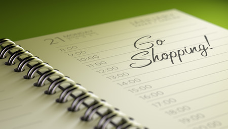 go to the shopping: Closeup of a personal calendar setting an important date representing a time schedule. The words Go shopping written on a white notebook to remind you an important appointment.