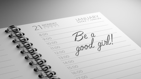 Closeup of a personal calendar setting an important date representing a time schedule. The words Be a good girl written on a white notebook to remind you an important appointment. Imagens