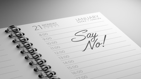 Closeup of a personal calendar setting an important date representing a time schedule. The words Say NO written on a white notebook to remind you an important appointment. Imagens