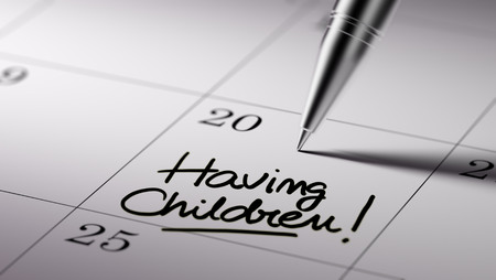 important date: Closeup of a personal agenda setting an important date written with pen. The words Having Children written on a white notebook to remind you an important appointment. Stock Photo