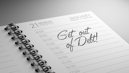 out of date: Closeup of a personal calendar setting an important date representing a time schedule. The words Get out of debt written on a white notebook to remind you an important appointment. Stock Photo