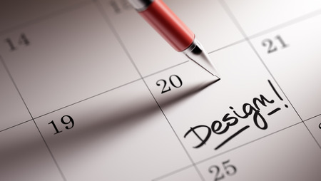 remind: Closeup of a personal agenda setting an important date written with pen. The words Design written on a white notebook to remind you an important appointment. Stock Photo