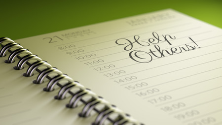 helping others: Closeup of a personal calendar setting an important date representing a time schedule. The words Help Others written on a white notebook to remind you an important appointment.