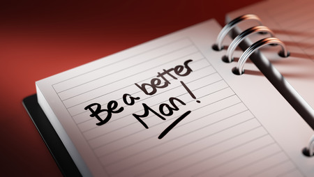 better days: Closeup of a personal agenda setting an important date representing a time schedule. The words Be a better man written on a white notebook to remind you an important appointment.