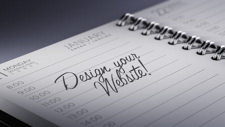 website words: Closeup of a personal calendar setting an important date representing a time schedule. The words Design your website written on a white notebook to remind you an important appointment.