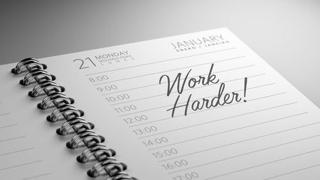 harder: Closeup of a personal calendar setting an important date representing a time schedule. The words Work Harder written on a white notebook to remind you an important appointment.