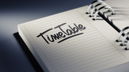 cronologia: Closeup of a personal agenda setting an important date representing a time schedule. The words Timetable written on a white notebook to remind you an important appointment.