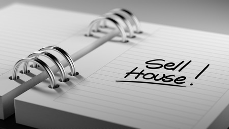 sell house: Closeup of a personal agenda setting an important date representing a time schedule. The words Sell House written on a white notebook to remind you an important appointment.