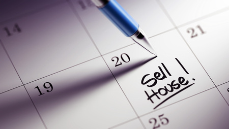 violet residential: Closeup of a personal agenda setting an important date written with pen. The words Sell House written on a white notebook to remind you an important appointment. Stock Photo