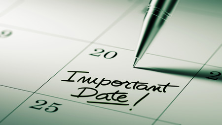 important date: Closeup of a personal agenda setting an important date written with pen. The words Important date written on a white notebook to remind you an important appointment.