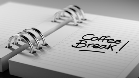 important date: Closeup of a personal agenda setting an important date representing a time schedule. The words Coffee Break written on a white notebook to remind you an important appointment.
