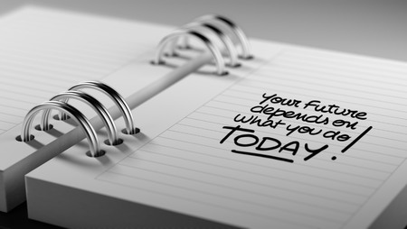depends: Closeup of a personal agenda setting an important date representing a time schedule. The words Your future depends on what you do today written on a white notebook to remind you an appointment.
