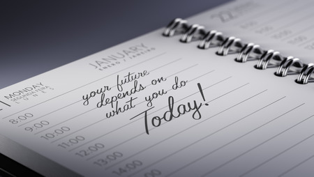 depends: Closeup of a personal calendar setting an important date representing a time schedule. The words Your future depends on what you do today written on a white notebook to remind you an appointment. Stock Photo