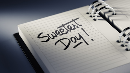 sweetest: Closeup of a personal agenda setting an important date representing a time schedule. The words Sweetest Day written on a white notebook to remind you an important appointment.