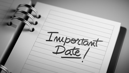 important date: Closeup of a personal agenda setting an important date representing a time schedule. The words Important date written on a white notebook to remind you an important appointment.