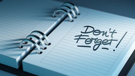 don't: Closeup of a personal agenda setting an important date representing a time schedule. The words Don`t Forget written on a white notebook to remind you an important appointment. Stock Photo