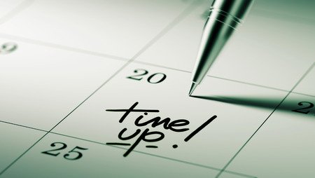 up to date: Closeup of a personal agenda setting an important date written with pen. The words Time up written on a white notebook to remind you an important appointment.