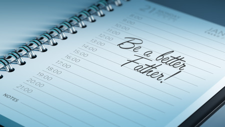 better days: Closeup of a personal calendar setting an important date representing a time schedule. The words Be a better father written on a white notebook to remind you an important appointment. Stock Photo