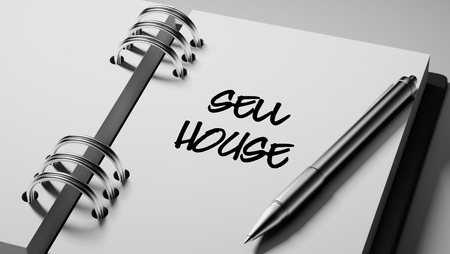 sell house: Closeup of a personal agenda setting an important date writing with pen. The words Sell House written on a white notebook to remind you an important appointment. Stock Photo
