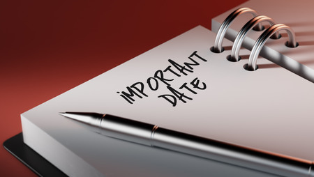 Closeup of a personal agenda setting an important date writing with pen. The words Important date written on a white notebook to remind you an important appointment.