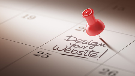 website words: Concept image of a Calendar with a red push pin. Closeup shot of a thumbtack attached. The words Design your website written on a white notebook to remind you an important appointment. Stock Photo