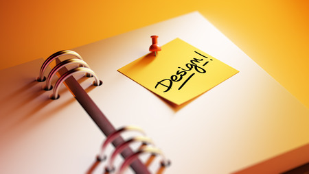 remind: Closeup Yellow Sticky Note paste it in a notebook setting an appointment. The words Design written on a white notebook to remind you an important appointment. Stock Photo