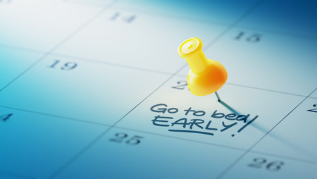 yellow push pin: Concept image of a Calendar with a yellow push pin. Closeup shot of a thumbtack attached. The words Go to bed early written on a white notebook to remind you an important appointment. Stock Photo